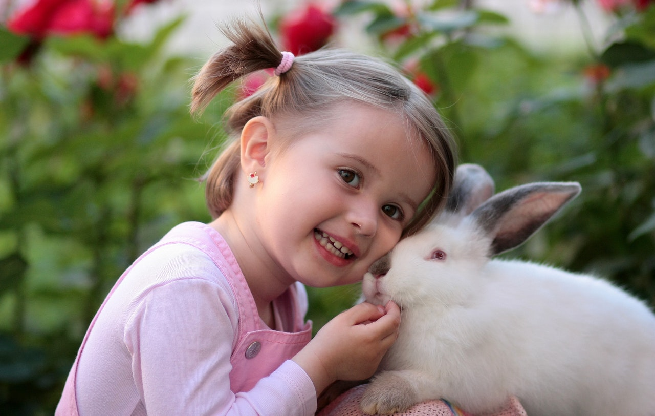 Young girl posing with a cute bunny